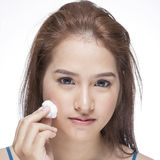 Woman cleaning her face with cotton swab Royalty Free Stock Photography