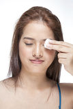 Woman cleaning her face with cotton swab Royalty Free Stock Photo
