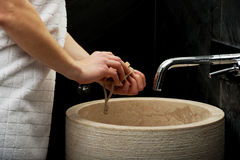 Woman cleaning her hands. Royalty Free Stock Images