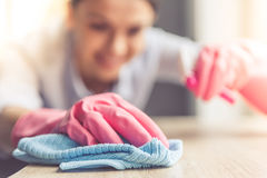 Woman cleaning her house Royalty Free Stock Images