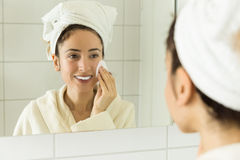 Woman cleaning her make up Stock Photography