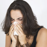 Woman cleaning her nose Royalty Free Stock Images