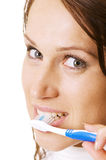 Woman cleaning her teeth Royalty Free Stock Image