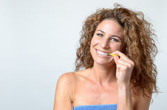 Woman cleaning her teeth with an interdental brush Stock Photography