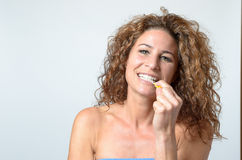 Woman cleaning her teeth with an interdental brush Royalty Free Stock Images