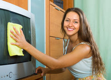 Woman cleaning home Stock Images
