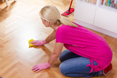 Woman Cleaning Home. Woman cleaning and mopping floor at home Stock Image