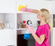 Woman cleaning home Stock Photo