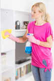 Woman cleaning home Royalty Free Stock Photo