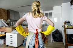 Woman cleaning the house alone Stock Images