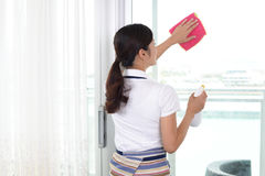 Woman cleaning the house Stock Images