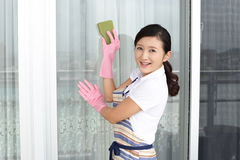 Woman cleaning the house Stock Photos