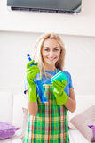 Woman cleaning house Royalty Free Stock Photos