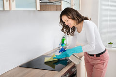 Woman Cleaning Induction Hob Royalty Free Stock Image