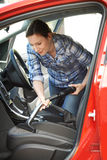 Woman Cleaning Inside Of Car Using Vacuum Cleaner Royalty Free Stock Photo