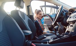 Woman cleaning inside of car. With vacuum royalty free stock images