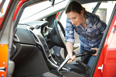 Woman Cleaning Interior Of Car Using Vacuum Cleaner Royalty Free Stock Photos