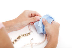 Woman cleaning a jewellery Royalty Free Stock Image