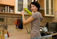 A woman  cleaning  a kitchen Stock Photos