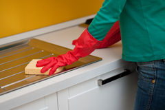 Woman cleaning kitchen. Female arms only cleaning kitchen Stock Photos