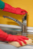 Woman cleaning kitchen. Female arms only cleaning kitchen Royalty Free Stock Image