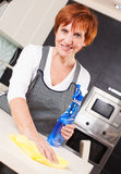 Woman cleaning kitchen Stock Photos