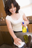 Woman Cleaning Kitchen Counter Stock Photo