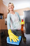 Woman cleaning kitchen counter Royalty Free Stock Photos