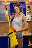 Woman cleaning kitchen floor Stock Photography