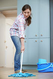 Woman Cleaning Kitchen Floor With Mop royalty free stock image