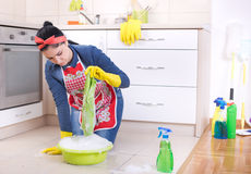 Woman cleaning kitchen floor Royalty Free Stock Photography