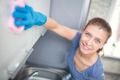 Woman cleaning in the kitchen royalty free stock photo