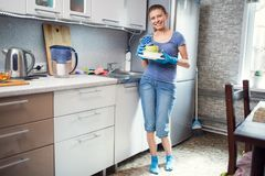 Woman cleaning in the kitchen stock photography