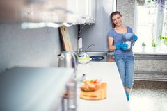 Woman cleaning in the kitchen stock photo