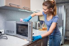 Woman cleaning in the kitchen. At home royalty free stock image