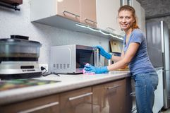 Woman cleaning in the kitchen stock image