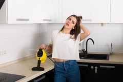 Woman cleaning kitchen with steam cleaner Stock Image