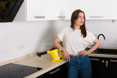 Woman cleaning kitchen with steam cleaner Royalty Free Stock Photography