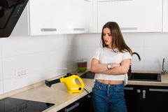 Woman cleaning kitchen with steam cleaner Royalty Free Stock Image