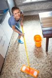 Woman cleaning in the kitchen washes the floor stock image