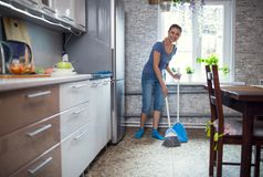 Woman cleaning in the kitchen washes the floor royalty free stock photos