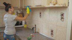 Woman cleaning in the kitchen stock video
