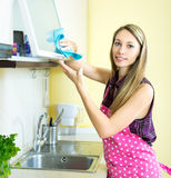 Woman cleaning kitchen Stock Photography