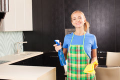 Woman cleaning kitchen Stock Photo