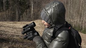 Woman cleaning lenses of binoculars at outdoors. Stock footage video stock video