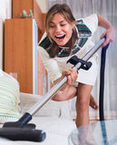 Woman cleaning in living room Stock Photography