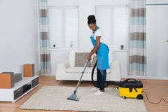 Woman Cleaning Living Room stock photo