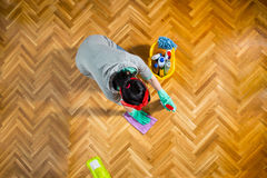 Woman cleaning and mopping floor at home. Royalty Free Stock Images