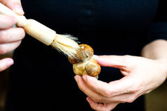 Woman cleaning mushrooms Royalty Free Stock Images