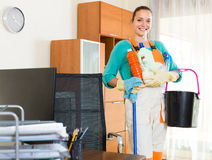 Woman cleaning at the office Royalty Free Stock Photos